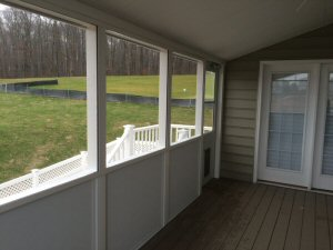 Screened porch with doggie door exit by Security Fence of Red Lion, PA