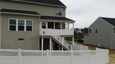 Raised screened-in deck with roof and patio below by Security Fence Company  York County PA